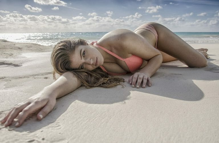Sexy girl laying on the beach